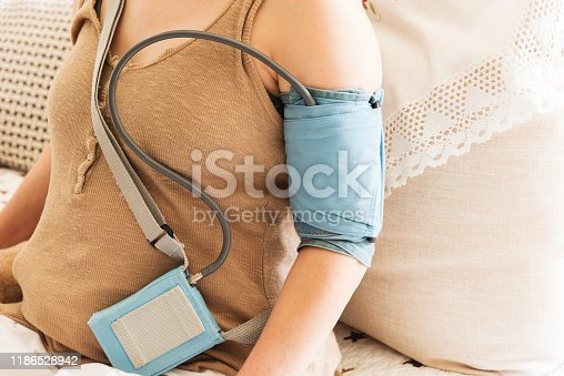 istock 24-hour blood pressure monitoring for women with ambulatory blood pressure monitoring equipment 1186528942
