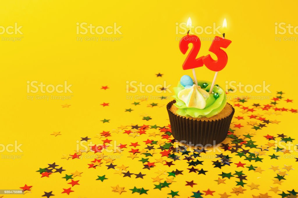 25th birthday cupcake with candle and sprinkles stock photo