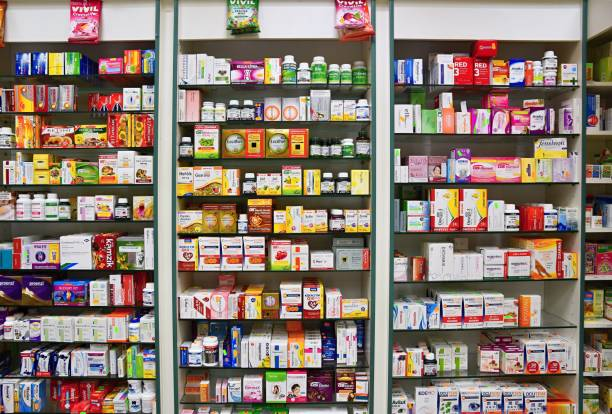 29th december 2017 brno - czech republic. background in pharmacy. goods in the shelf. medicines and vitamins for health and healthy lifestyle. concept for business and sales - store counter stock photos and pictures
