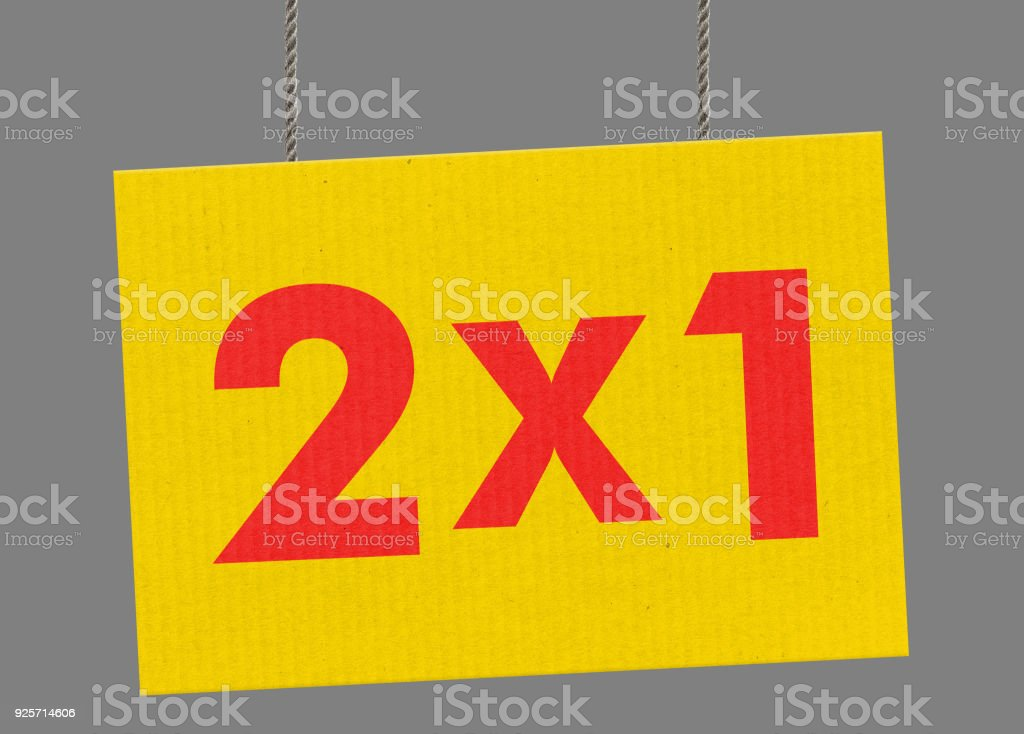 2x1 sign hanging from ropes. Clipping path included so you can put your own background. stock photo