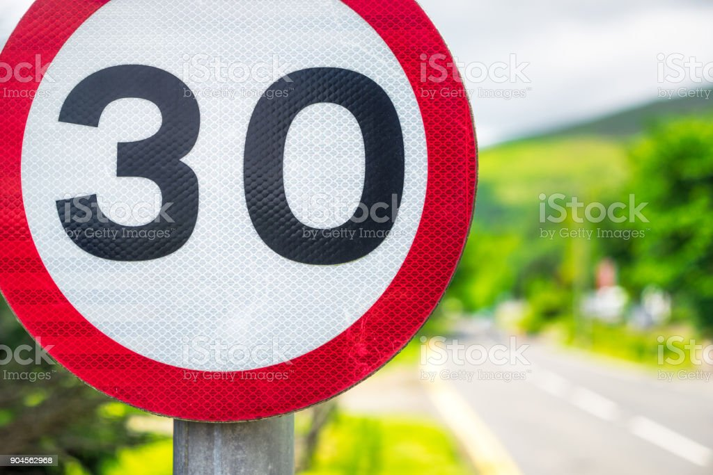 30mph speed limit sign by British road stock photo