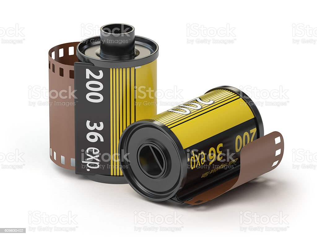 35mm camera photo film canisters isolateed on white. stock photo