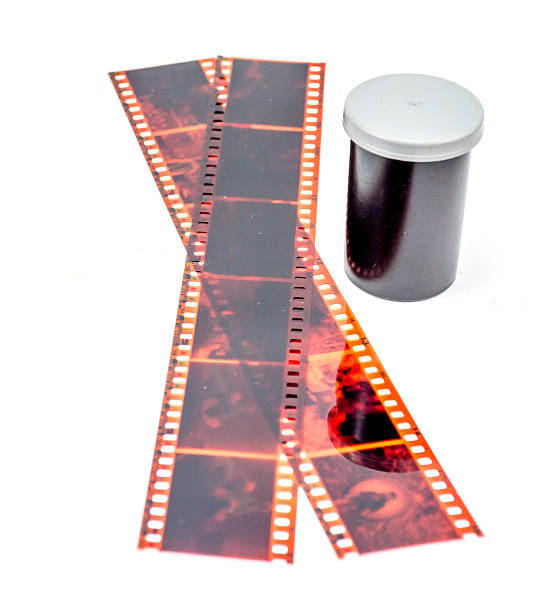 35mm film negative and roll container 35mm film negative and roll container on white background negative image technique stock pictures, royalty-free photos & images