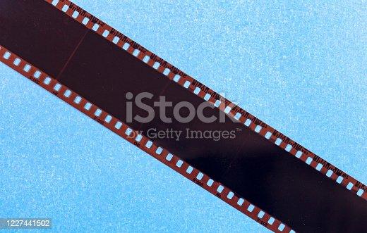 35mm film strip. twisted film strip on blue background