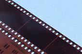 35mm film strip. twisted film strip on white background