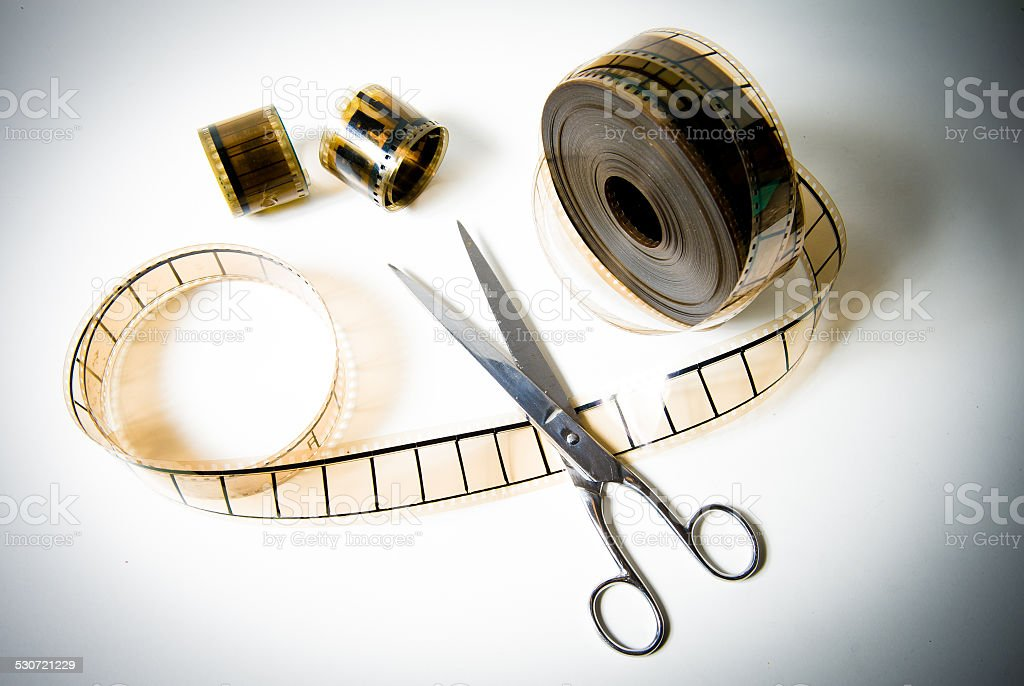 35mm movie reel and scissors for the final cut stock photo