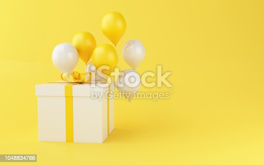 istock 3d Balloons and gift boxes on yellow background. 1048834766
