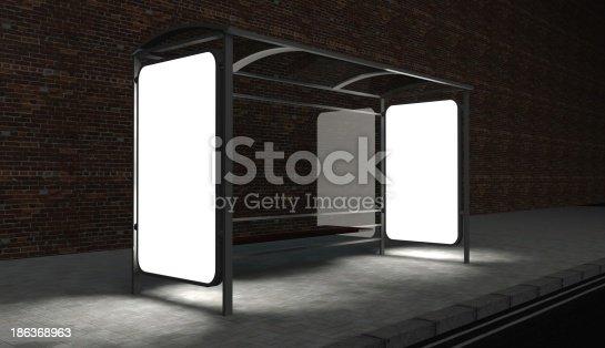 istock 3d Blank billboard on bus stop at night 186368963