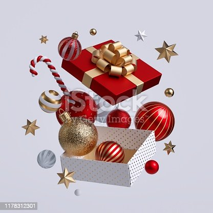 istock 3d Christmas gift box opened, ornaments flying out. Festive clip art isolated on white background. Seasonal winter holiday decor: glass balls, golden stars, candy cane. 1178312301