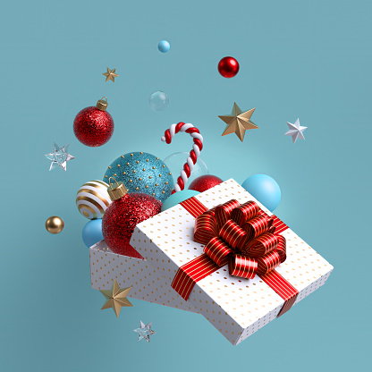 3d Christmas ornaments and glass balls falling out, open white wrapped box with red bow. Winter holiday package. Levitating objects. Festive clip art isolated on blue background