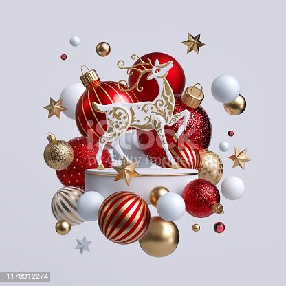 istock 3d Christmas reindeer with ornaments isolated on white background. Decorative deer with golden antlers standing on white pedestal surrounded with colorful glass balls. Holiday clip art. 1178312274