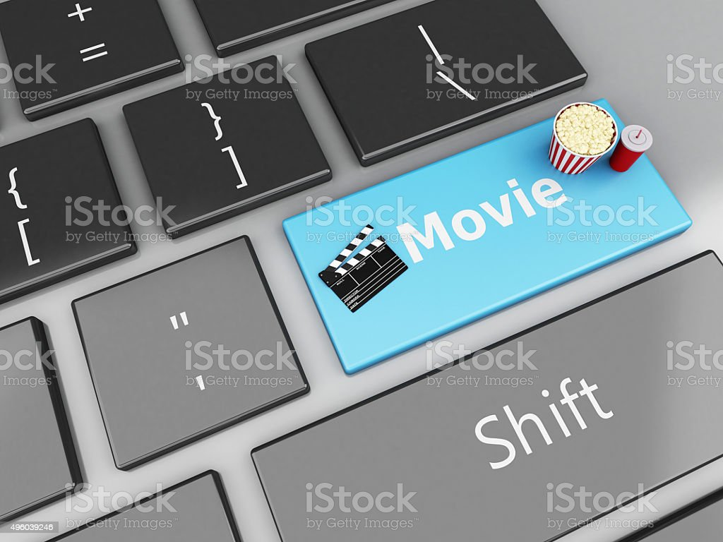3d Clapper board with popcorn on computer keyboard. stock photo
