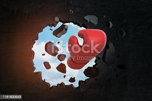 160558362 istock photo 3d closeup rendering of red boxing glove breaking hole in black wall with blue sky seen through hole. 1181600553