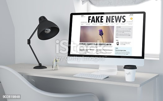 3d rendering of a desktop workplace with computer fake news website. All screen graphics are made up.