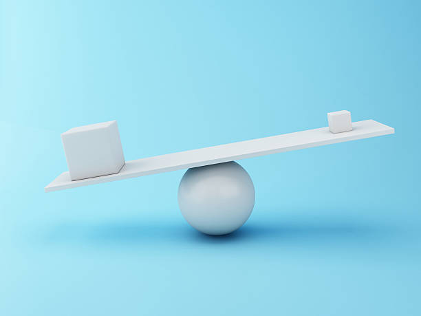 3d Different cubes balancing on a seesaw. stock photo