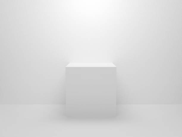 3d exhibition stand. White blank empty podium isolated on gray background for presentation and exposition. Abstract 3d cube for mock up store. Pedestal for display product. Interior stage design. stock photo