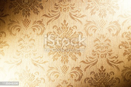 istock 3d illustration graphic background of floral patterns and leaves on a gold cloth material 1135648356
