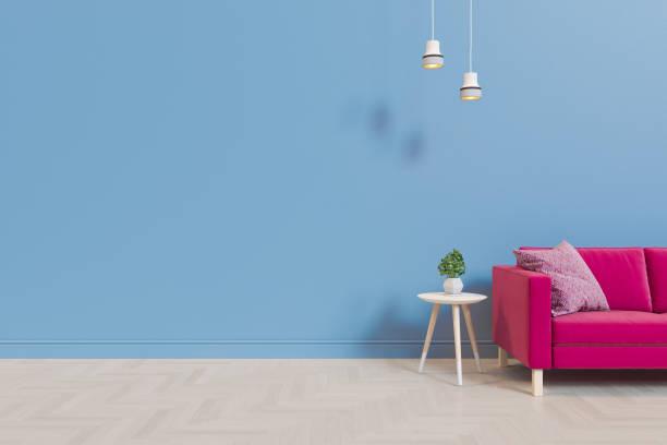illustration 3d d'un salon avec un sofa en tissu sur le fond d'un mur vide et d'un plancher en bois. rendu pour se moquer - élément graphique photos et images de collection