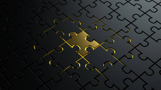 3d illustration of puzzle pieces background texture with a golden colored one in center stock photo