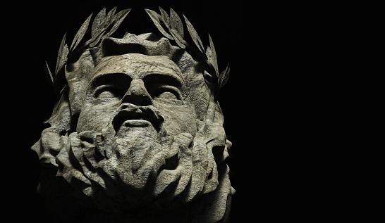 3d render illustration of stone greek god Zeus face on black background.