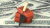 3d illustration: Three red silicate bricks stacked in a pile with a tool for laying mortar - trowel on dollars banknotes background. Business metaphor concept: planning and construction of housing.