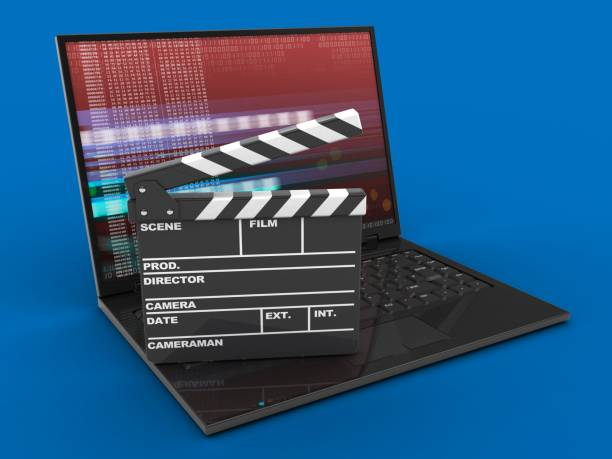 3d laptop computer and film clap stock photo