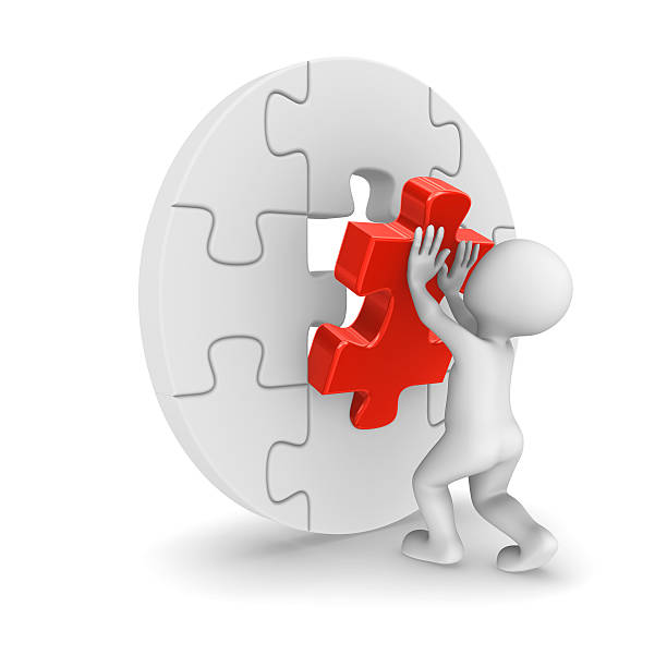3d man assembling puzzle piece ストックフォト