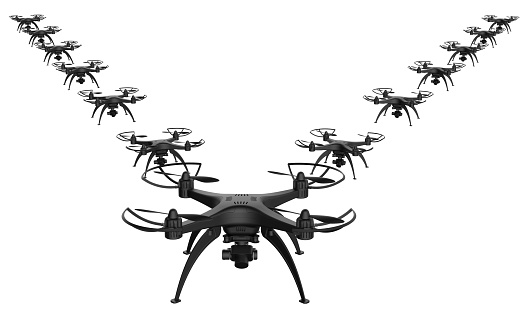 istock 3d of a wedge of drones on a white background 919589636