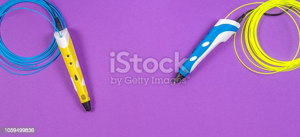 istock 3d pens with colourful plastic filament on purple background 1059499836