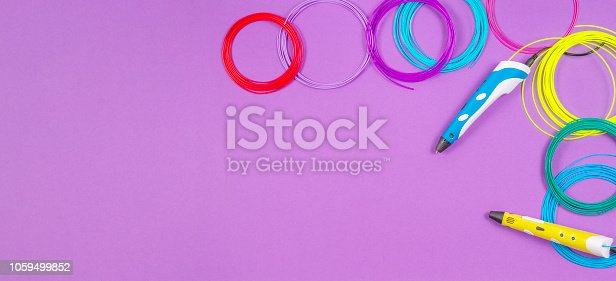 istock 3d pens with colourful plastic filament on purple background 1059499852