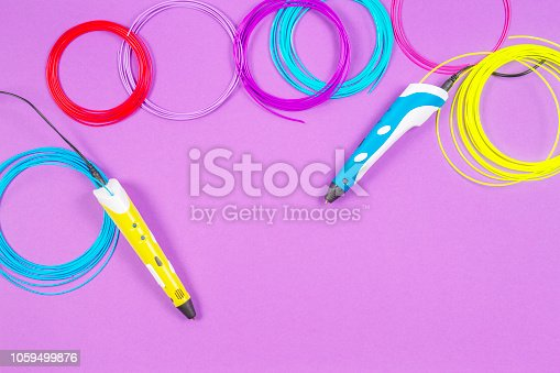 istock 3d pens with colourful plastic filament on purple background 1059499876