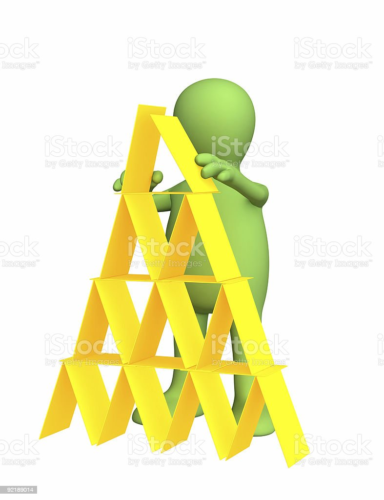 3d person - puppet, making a pyramid from plastic cards royalty-free stock photo