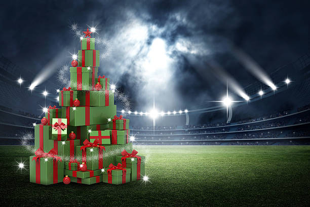 3d present boxes, christmas tree concept in the stadium - new year стоковые фото и изображения