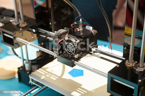 istock 3d printer creating a new plastic object close-up 1002097358