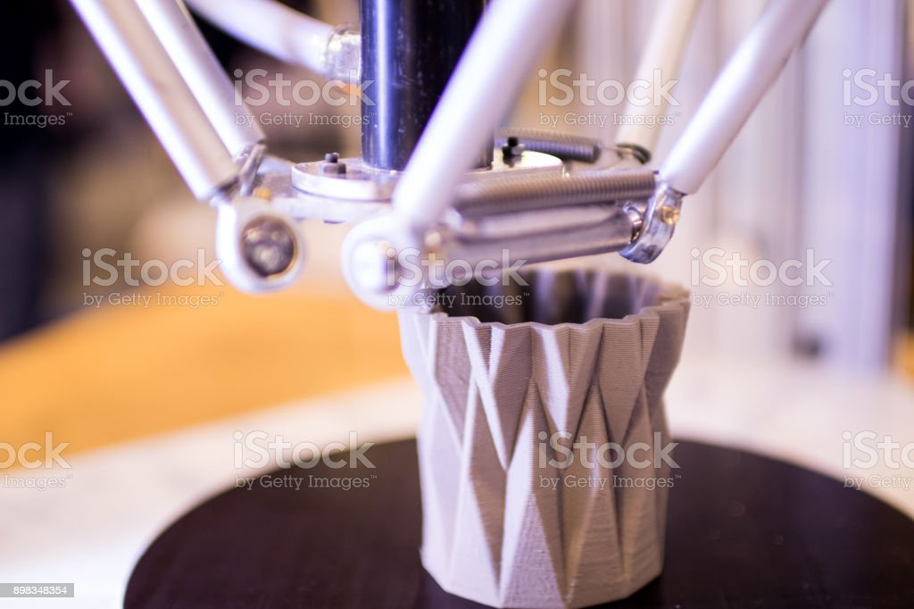 3d printer during the processing of a digital craft object stock photo