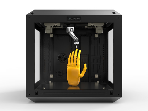 istock 3d printer with object 908437390