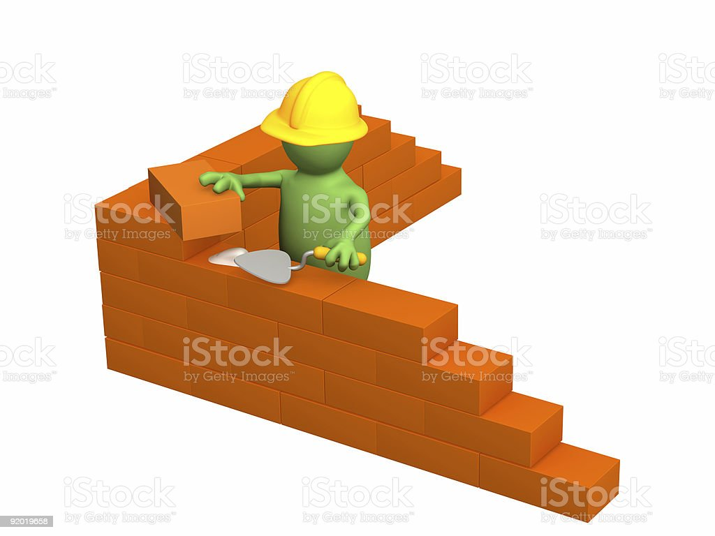 3d puppet - builder, building a brick wall royalty-free stock photo