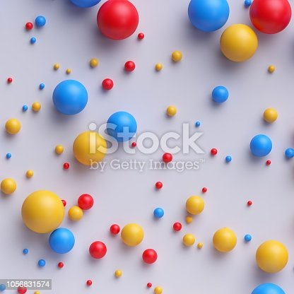 istock 3d render, abstract colorful balls, beads, candies, pills, red blue yellow mixed colors, isolated on white background 1056831574
