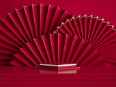 istock 3d render, abstract red background with empty square pedestal and chinese folded paper fans. Fashion podium stage platform, blank showcase template for product display 1265008355