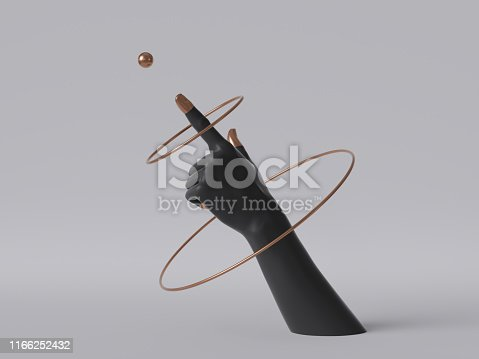 istock 3d render, black decorative female mannequin hand isolated on white background, finger pointing up, spinning golden rings, body part, fashion concept, esoteric fortuneteller, clean minimal design 1166252432