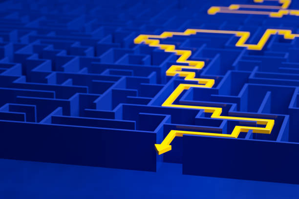 3d render: Concept - solving a complex problem. Blue maze with yellow solution path with arrow. stock photo