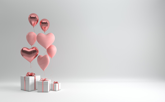 istock 3d render illustration of realistic pastel pink and rose gold balloons and gift box with bow on white background. Empty space for party, promotion social media banners, posters. Heart shape balloons 1092912694