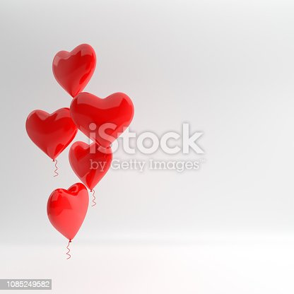 istock 3d render illustration of realistic red glossy heart balloons on white background. Valentine's Day romantic elegant 14 february greeting card. Empty space for party, promotion social media banners, posters. 1085249582