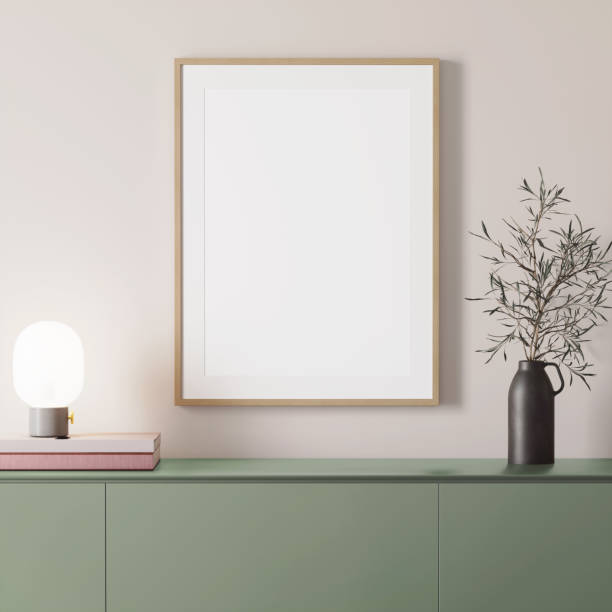 3d render of a modern mockup interior with wooden frame on an empty wall and a green sideboard stock photo