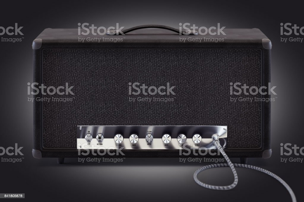 3d render of analog guitar amplifier with inserted audio cable and shining chrome round knobs. stock photo