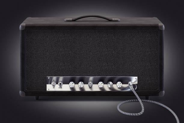 3d 渲染類比吉他放大器與插入音訊電纜和閃亮的鍍鉻圓形旋鈕。圖像檔