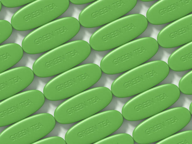 3d render of green tea pillen - grüner tee kapseln stock-fotos und bilder