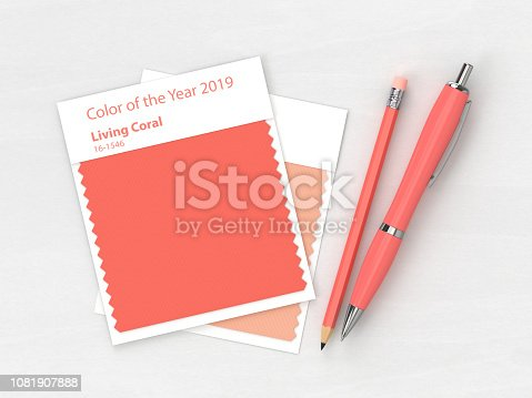 3d render of stationery with  textile color swatch lying on wooden desk. Living coral. Color of the year 2019.