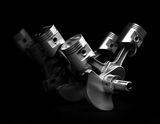3d render of V8 engine pistons 3d render of V8 engine pistons and cog on black background. piston stock pictures, royalty-free photos & images