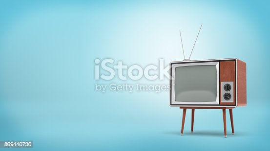 istock 3d rendering a retro TV set with a long antenna and a blank screen stands on a four-legged table on blue background. 869440730